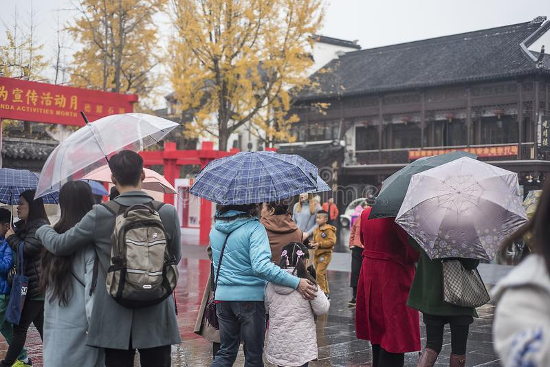 In the early winter, a light rain, the tourists in the Confucius Temple area are still a lot of tourists. stock image
