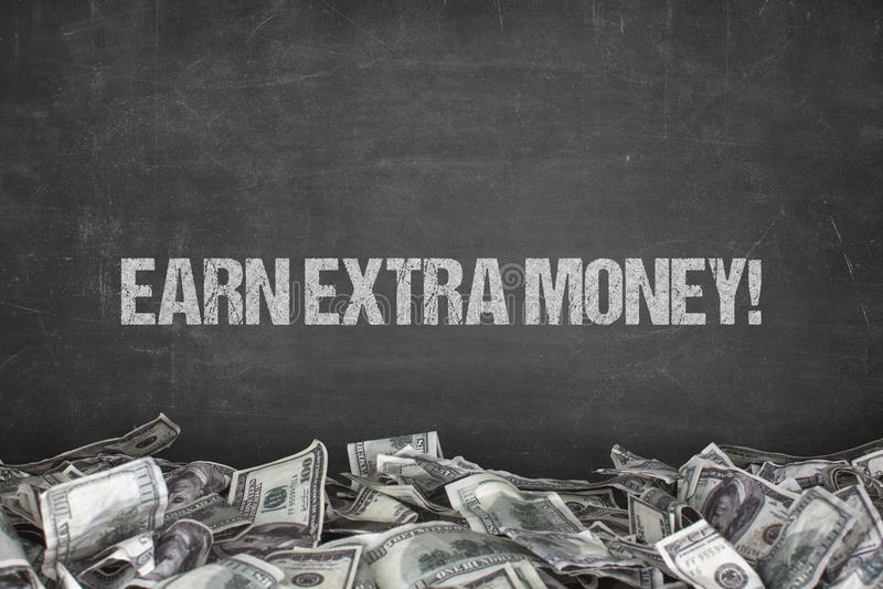 Earn extra money text on black background stock photos
