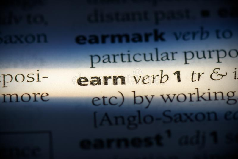 Earn. Word in a dictionary.  concept, definition stock images