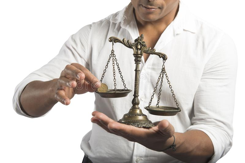 Earning balance. Concept of earning balance with businessman that weighs the money stock photo