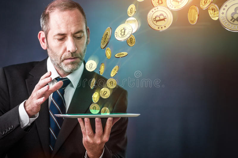 Earning Bitcoins. Earning lots of bitcoins with tablet PC - bit coin BTC the new virtual money stock image