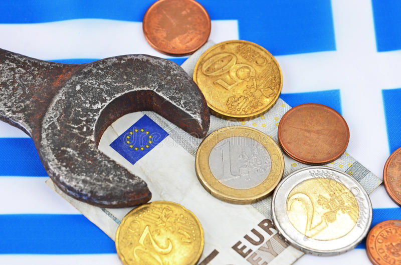 Earning in Greece concept with money and wrench royalty free stock photo
