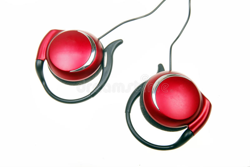 Earphone. Red portable earphone on white stock photography