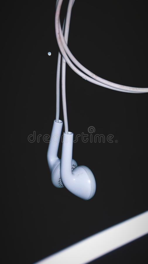 Earphone. Black and white no people no model night stock photo