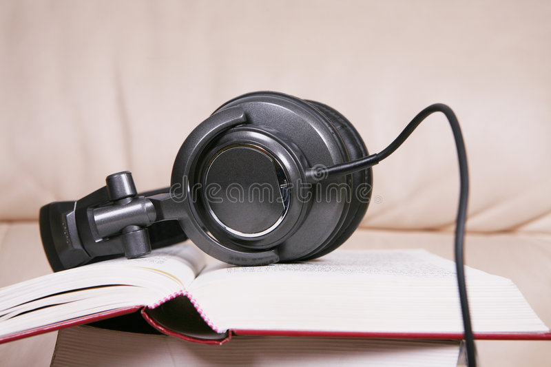 Download Earphone With Book Royalty Free Stock Photography - Image: 6132567