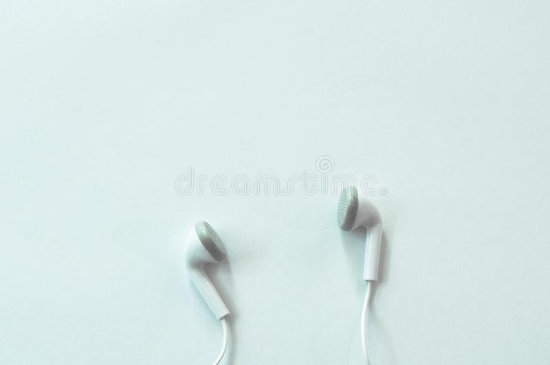Earphone for connecting with mobile phone arranging on white background. Earphone for connecting with mobile phone arranging isolated on white background royalty free stock images