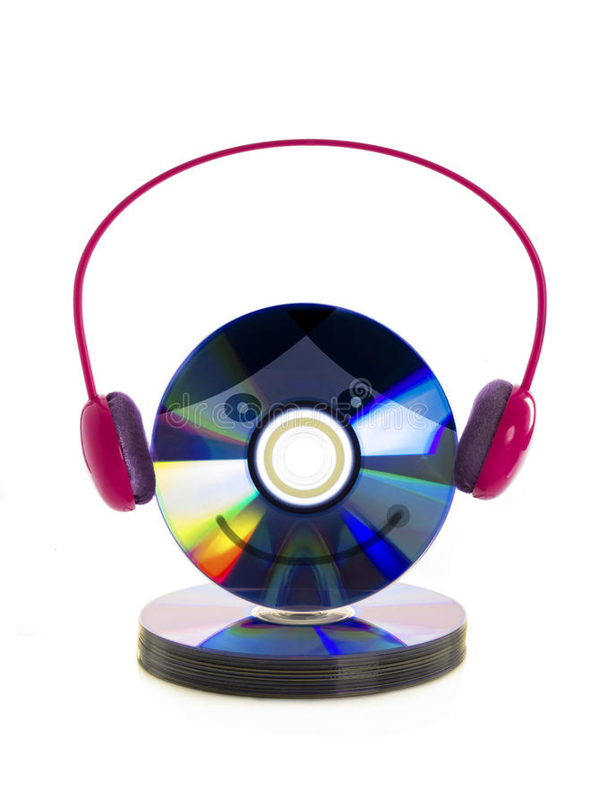 Earphone and DVD disc. Happiness to listening music concept. Isolated over white background royalty free stock photo