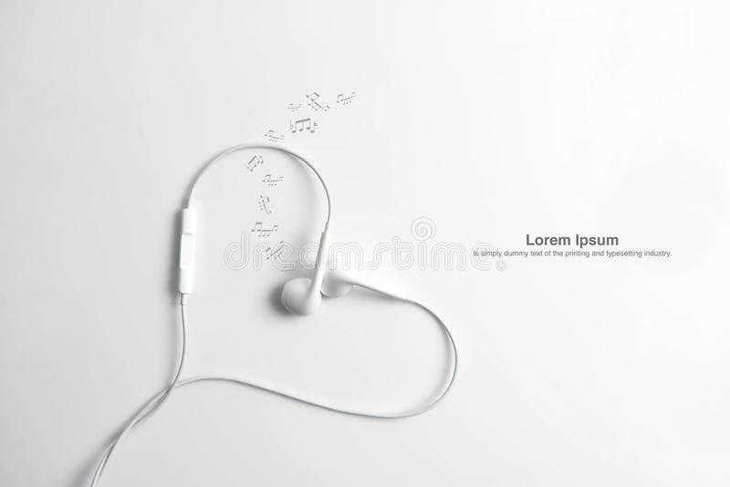 Earphone in shape of heart. on white background. White earphone and cord in shape of heart. on white background royalty free stock images