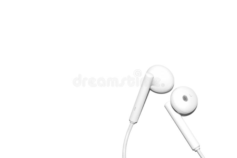 Earphone. White earphone for listening music isolated white background royalty free stock photo