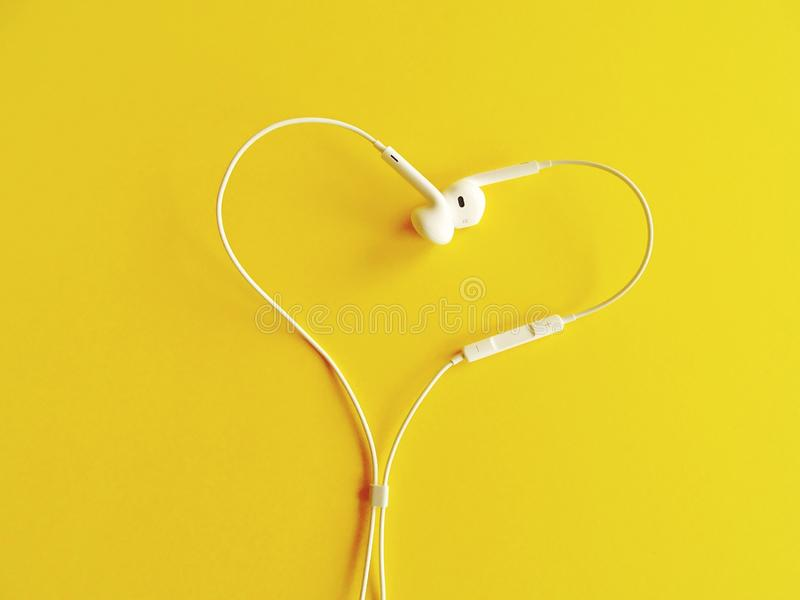 Earphone. On yellow background stock images