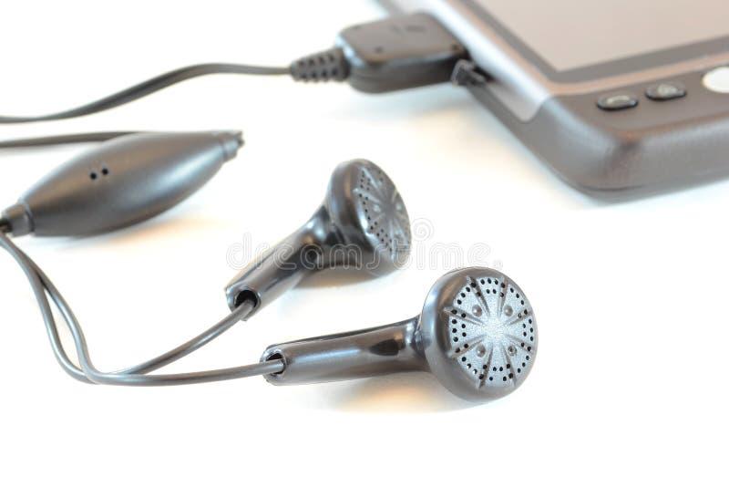 Earphones and mobile phone stock photo
