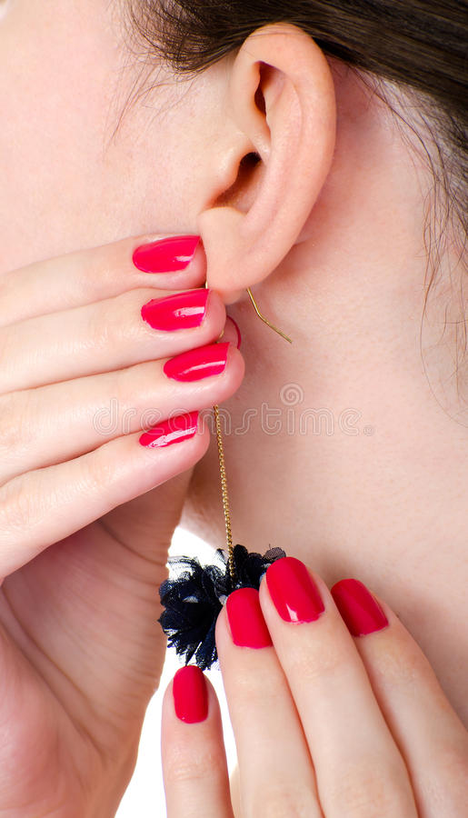 Download Earring stock image. Image of nail, cosmetics, holding - 23758595