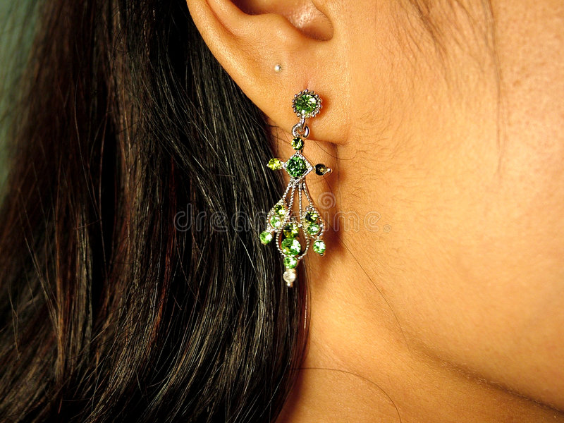 Earring. Close up - women and earring stock photography