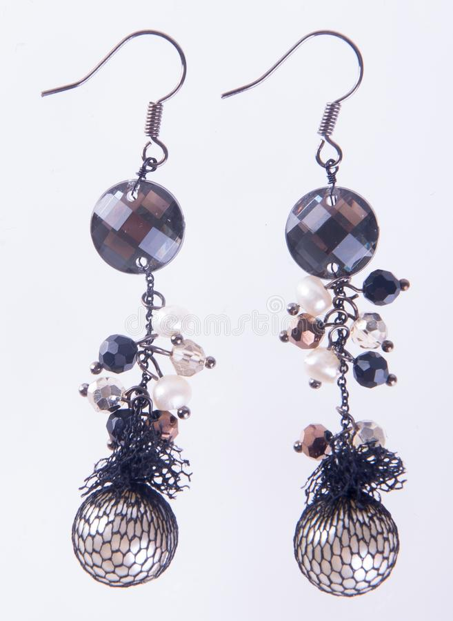 Earring. earring on the background.  royalty free stock images