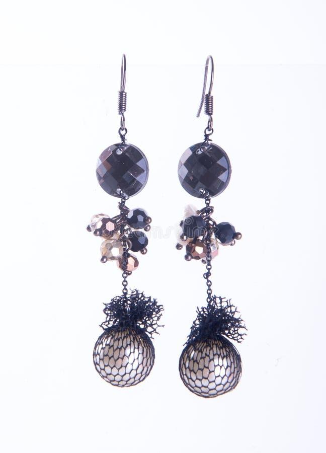 earring orecchino sui precedenti immagine stock