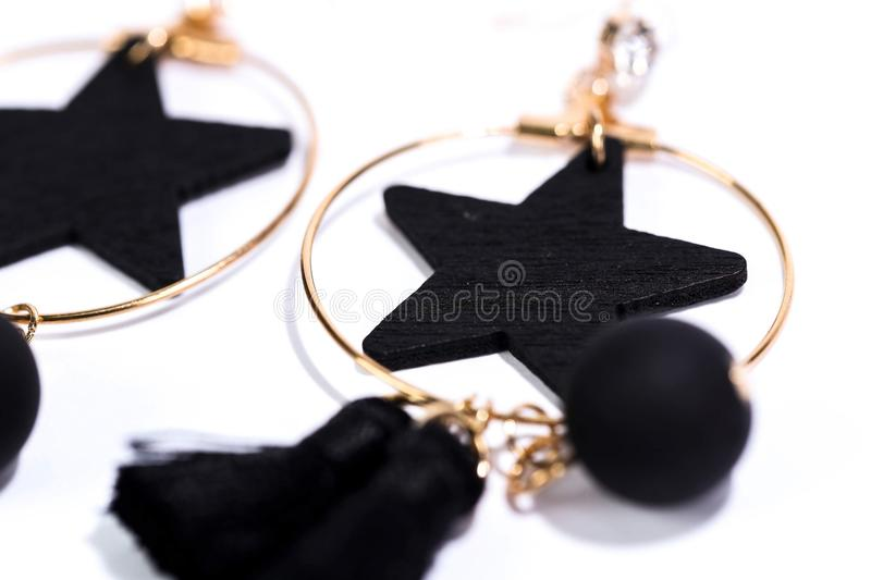 Earrings. Black earrings add elegance to women who wear them royalty free stock photos
