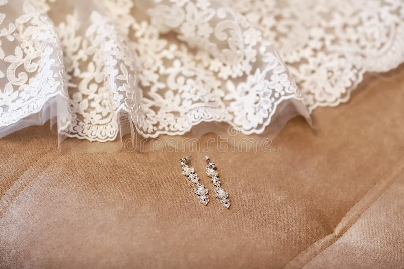 Earrings for brides with white lace, fashion accessories, wedding jewelry stock photography