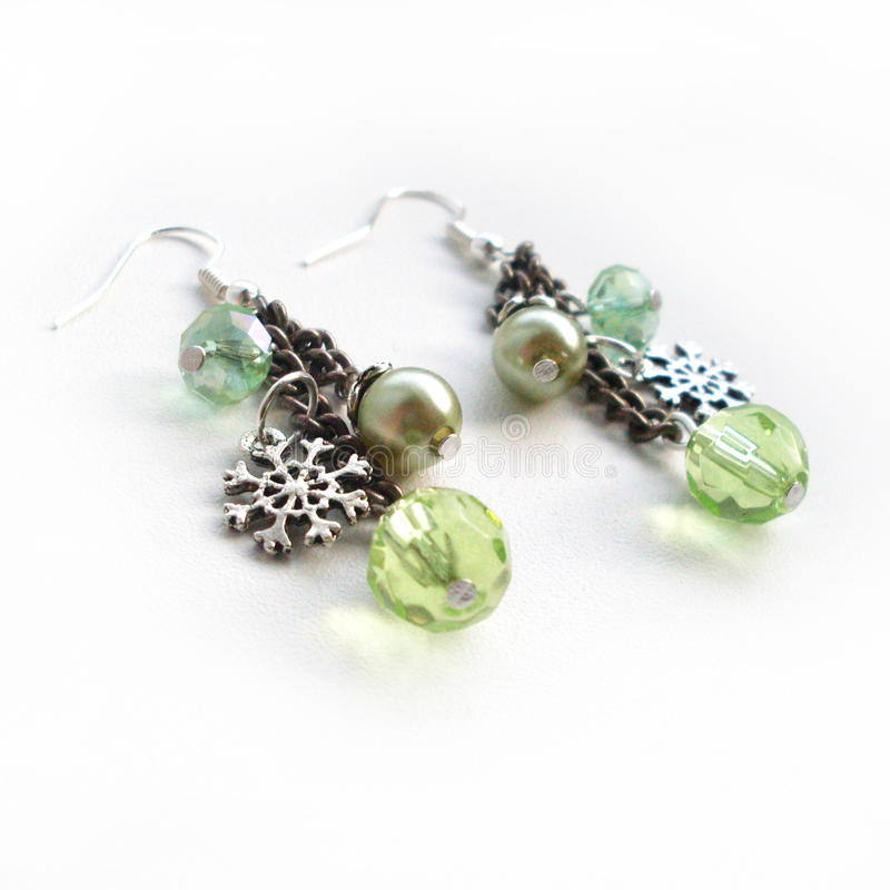 Earrings on a chain with pendants stock images