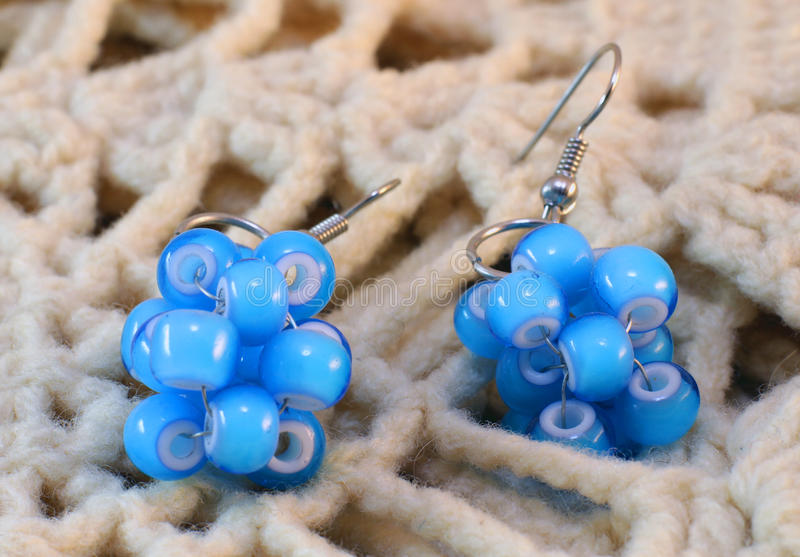 Earrings made of blue beads royalty free stock image