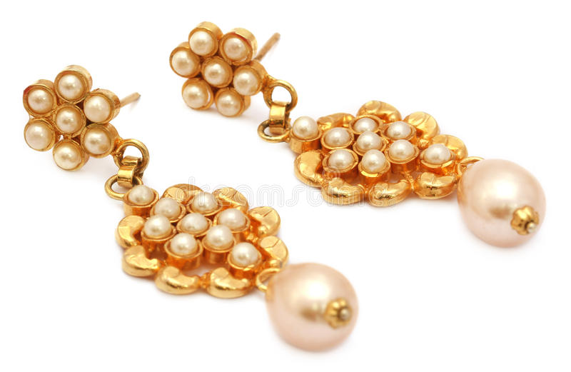 Earrings made of gold and pearls royalty free stock image