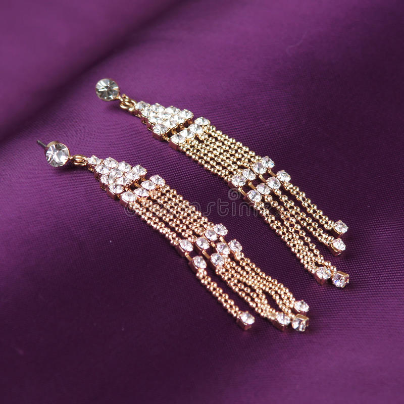 Download Earrings On Purple Background Stock Image - Image: 27336155