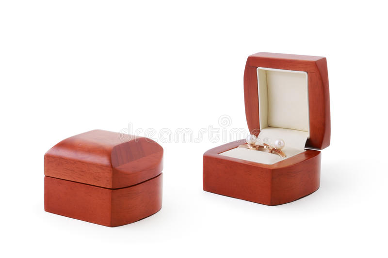 Earrings in a wooden box royalty free stock images