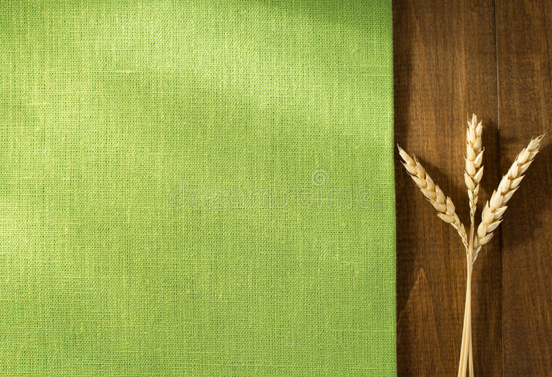Ears of wheat on wood royalty free stock photography
