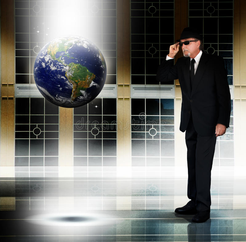Man inspecting Earth stock image