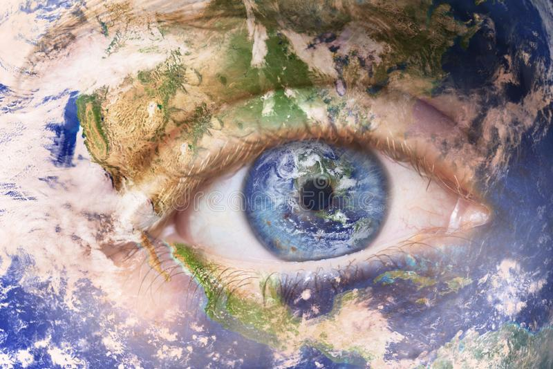 Earth awakening concept, save the planet. Close up image of woman face with earth painted. Creative composite of macro. Eye with Earth as Iris. Elements of this stock photos