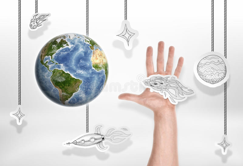 The Earth on background of small pictures with stars and male hand stock photography