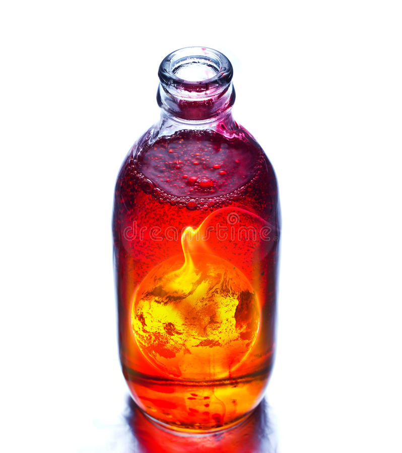 Earth burning in the bottle and red water boil. Bubble royalty free stock photo