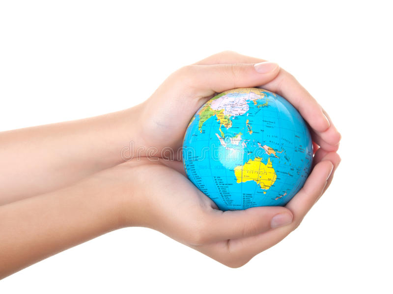 Earth in a children's hands royalty free stock photography