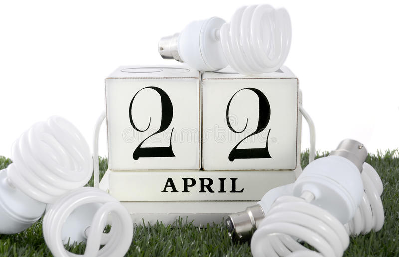 Earth Day, April 22, concept with energy saving light bulbs. stock images