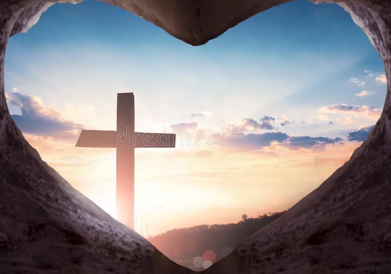 Easter concept: Jesus Christ empty grave on the cross background. Earth Day concept: hands holding earth globe and tree over blurred nature background stock image