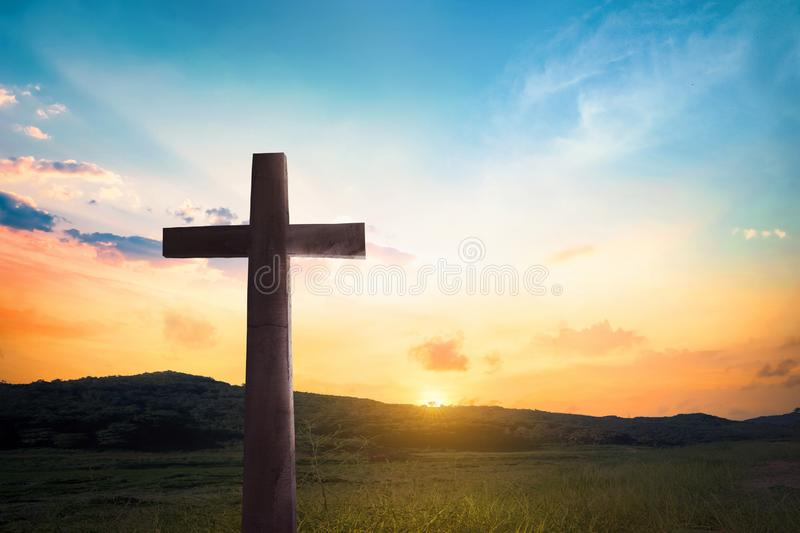 Religious concept: Jesus Christ wooden cross with dramatic lighting background stock photography