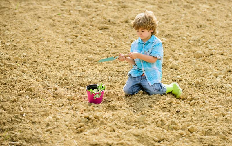 Earth day. Eco life. summer farm. ecology life. eco farm. human and nature. happy child seeding on rich soil. Spring. Season. small kid planting a flower stock images