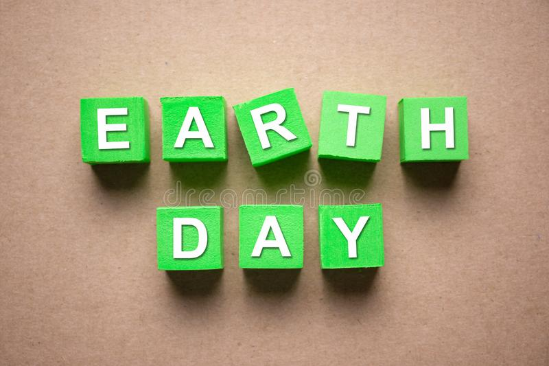 Earth day on green color blocks royalty free stock images