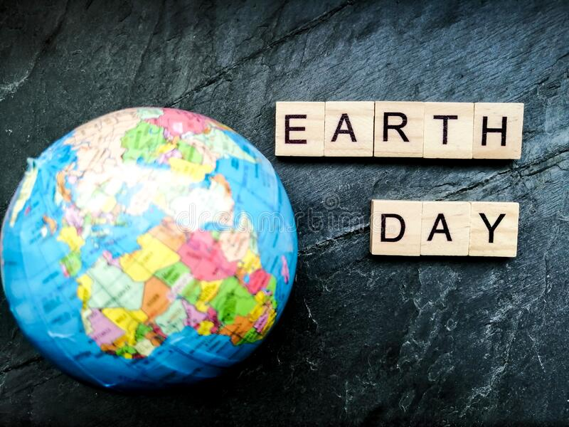 Earth day on grey background. Earth day text on grey background royalty free stock photo
