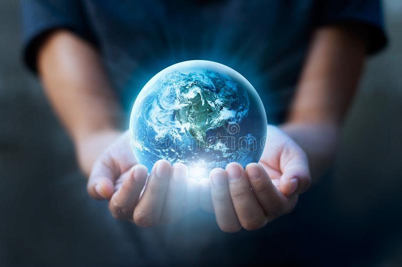 Human hands holding blue earth, save earth concept. royalty free stock photos