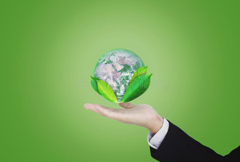 Earth day, Protect the world with environment and Eco-friendly business. Businessman hand holding globe with leaves. Element of th stock photo