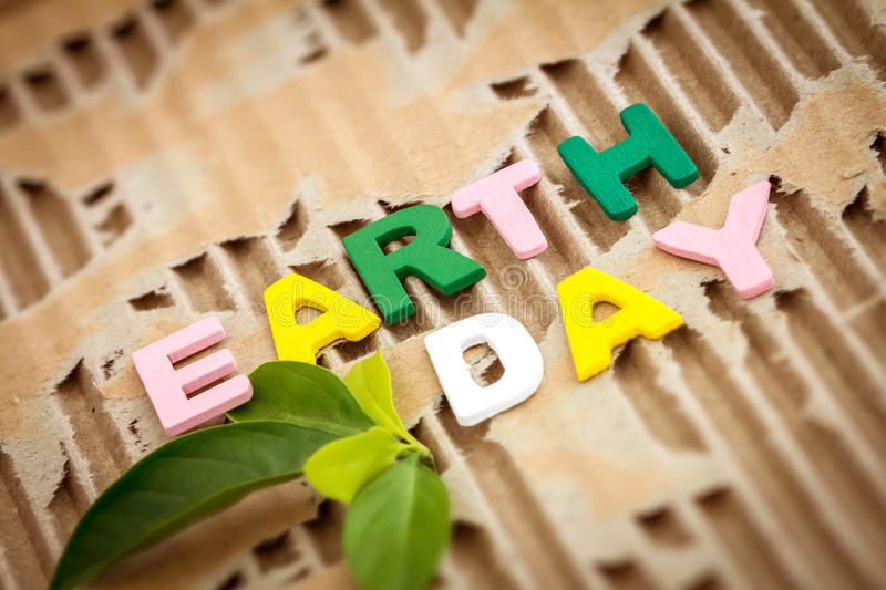 Earth Day wording on abstract torn cardboard. Background stock images