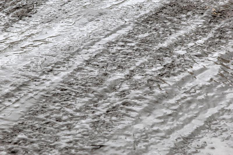 Dirt on the road texture. Earth dirty wet terrene dirty road wet sand texture for text stock photo