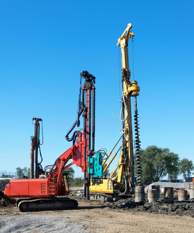 Earth drilling machines in the construction field stock images