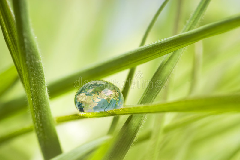 The earth in a drop stock photography
