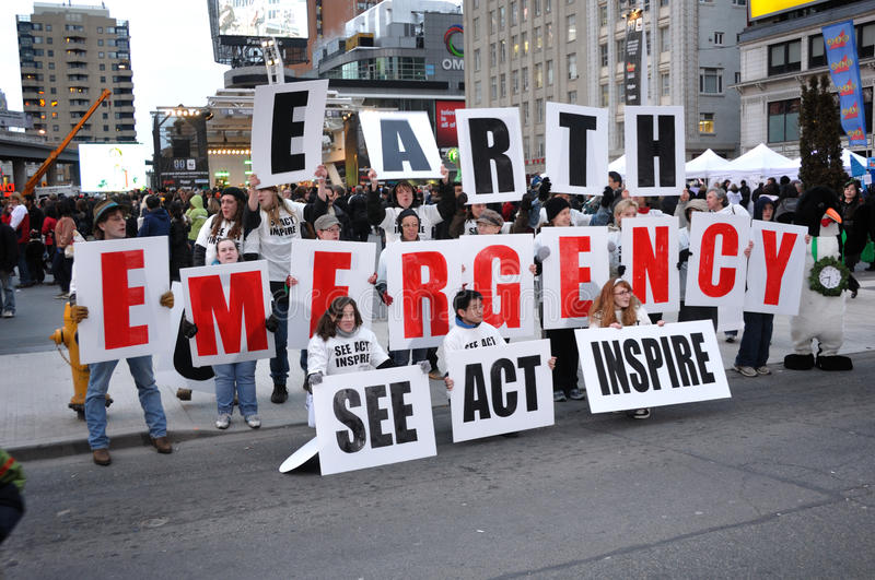 Earth Emergency. A group of environmentalist in Toronto on the Earth Day stock images