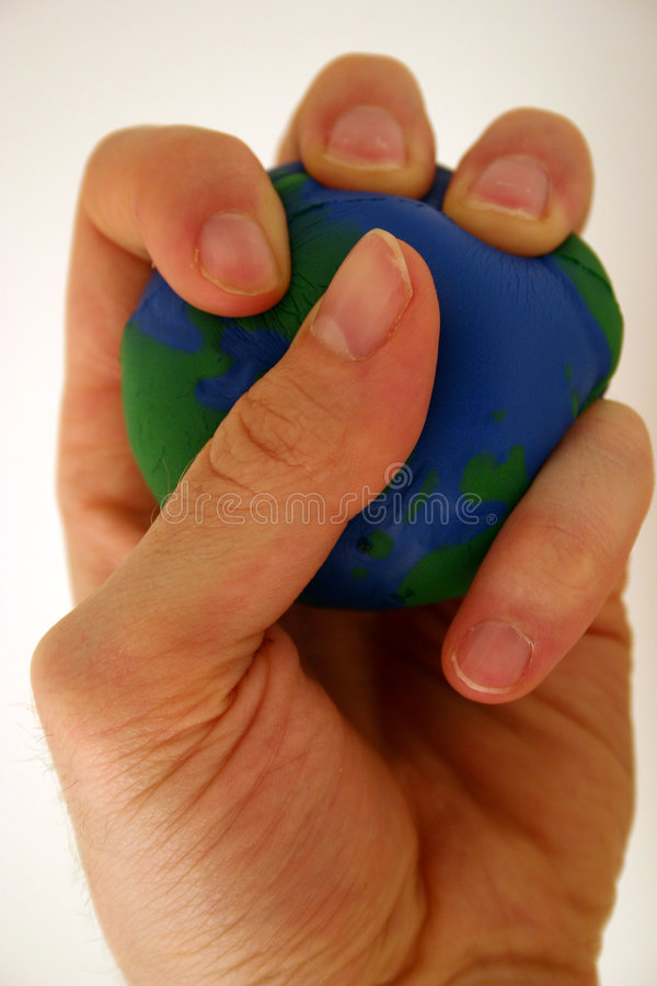 Earth and environment. Human activity putting the squeeze on the earth (global warming, pollution, etc royalty free stock photos