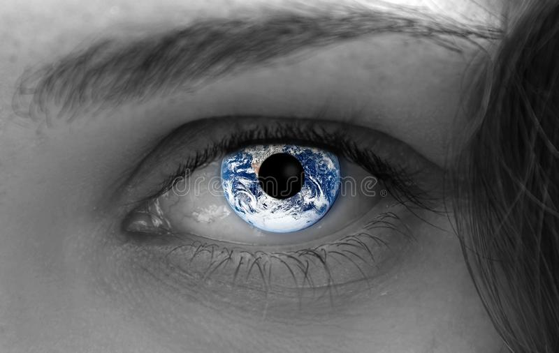 Earth in the eye stock photos