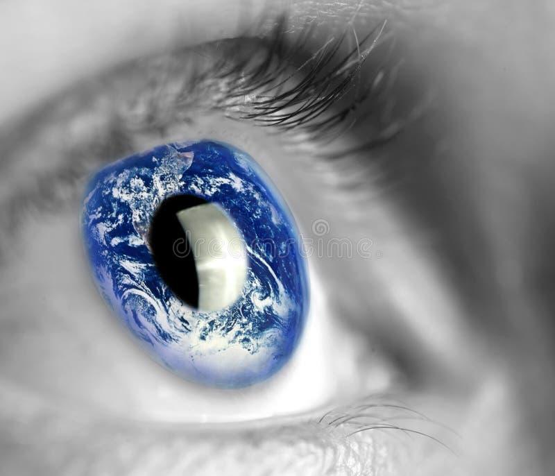 Earth in eye stock photos