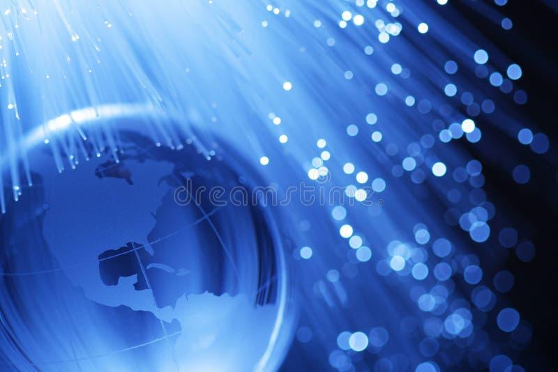 Earth & fiber optics. Earth and fiber optics in blue royalty free stock photos