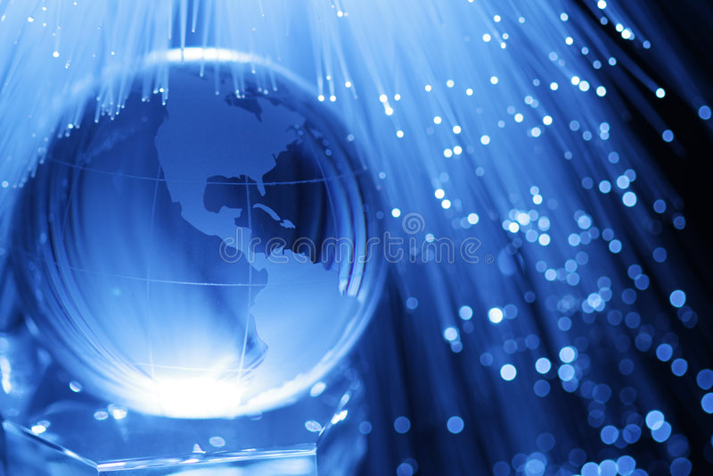 Earth & fiber optics. Earth in blue fiber optics stock photography